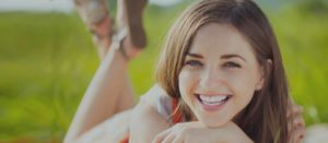 lakewood and littleton orthodontist - smiling young woman-darker shade
