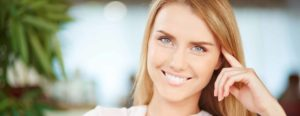clear-braces-woodland-park-smiling-young-woman